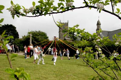 The children of Madron dance around the maypole in the Memorial Garden