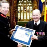 Lord Lieutenant of Cornwall Col. Edward Bolitho OBE presenting a certificate to John Laity OBE
